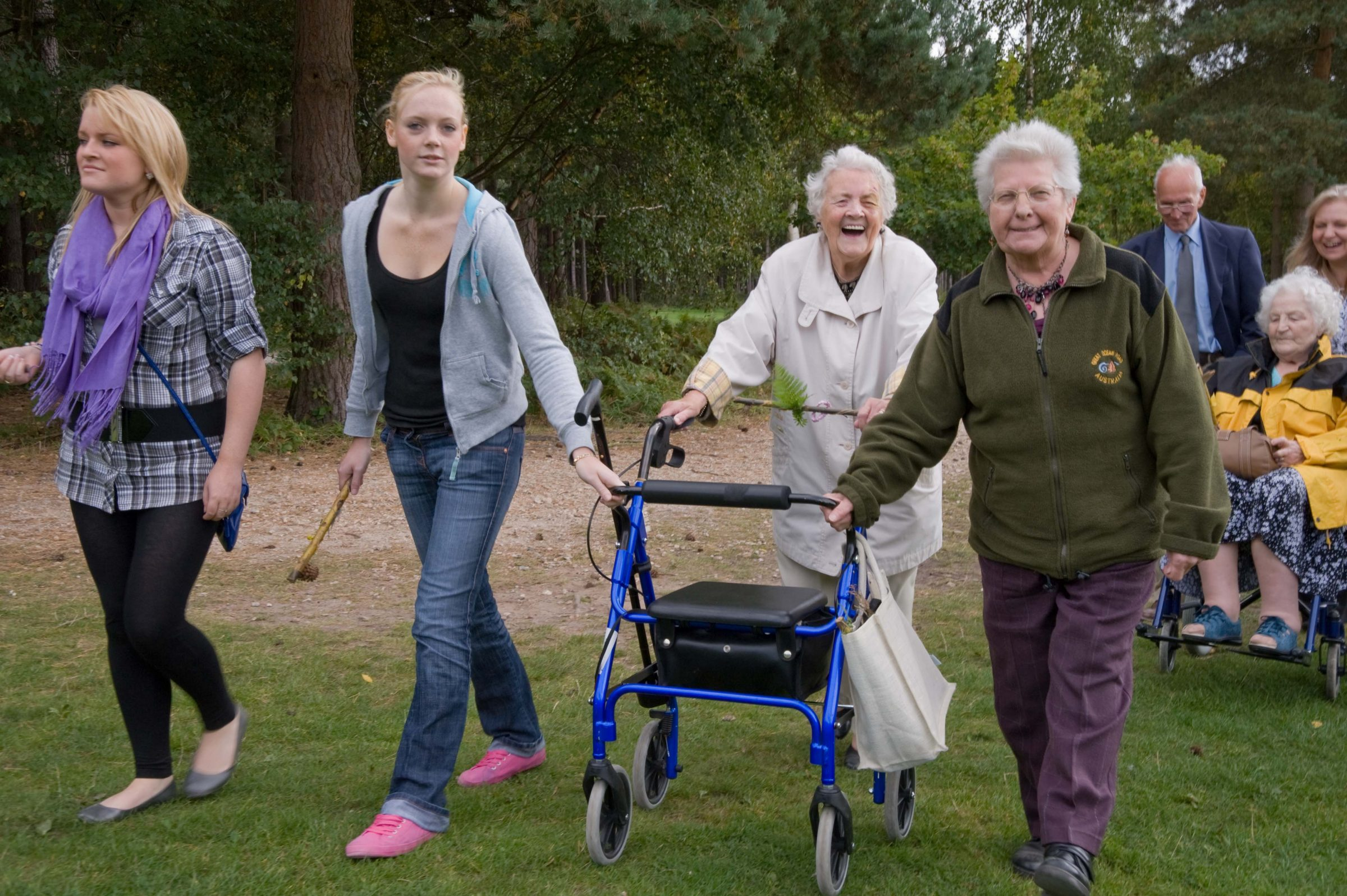 Photo of older and younger people out on a walk