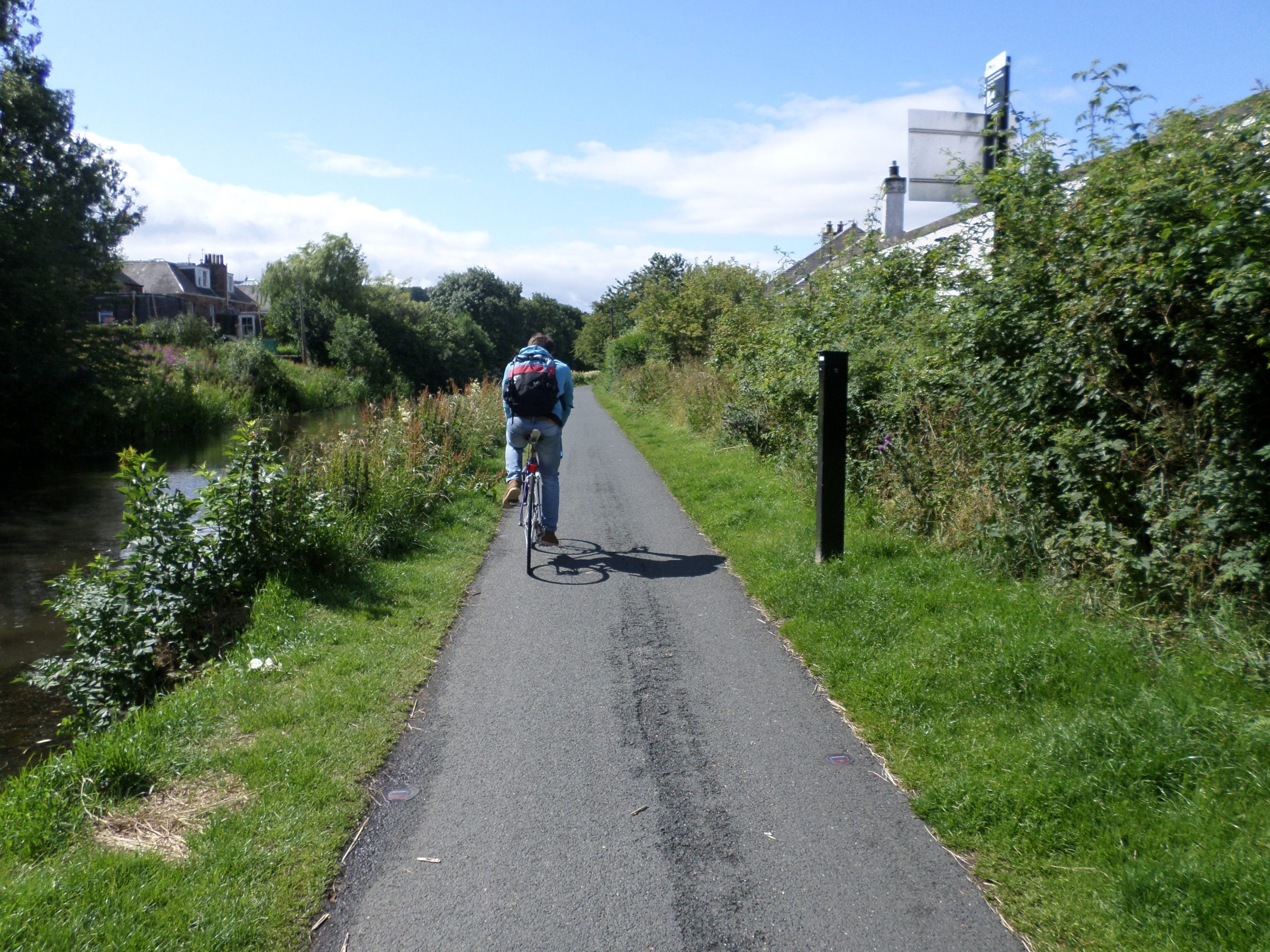 Photo of a cyclist on a canal towpath